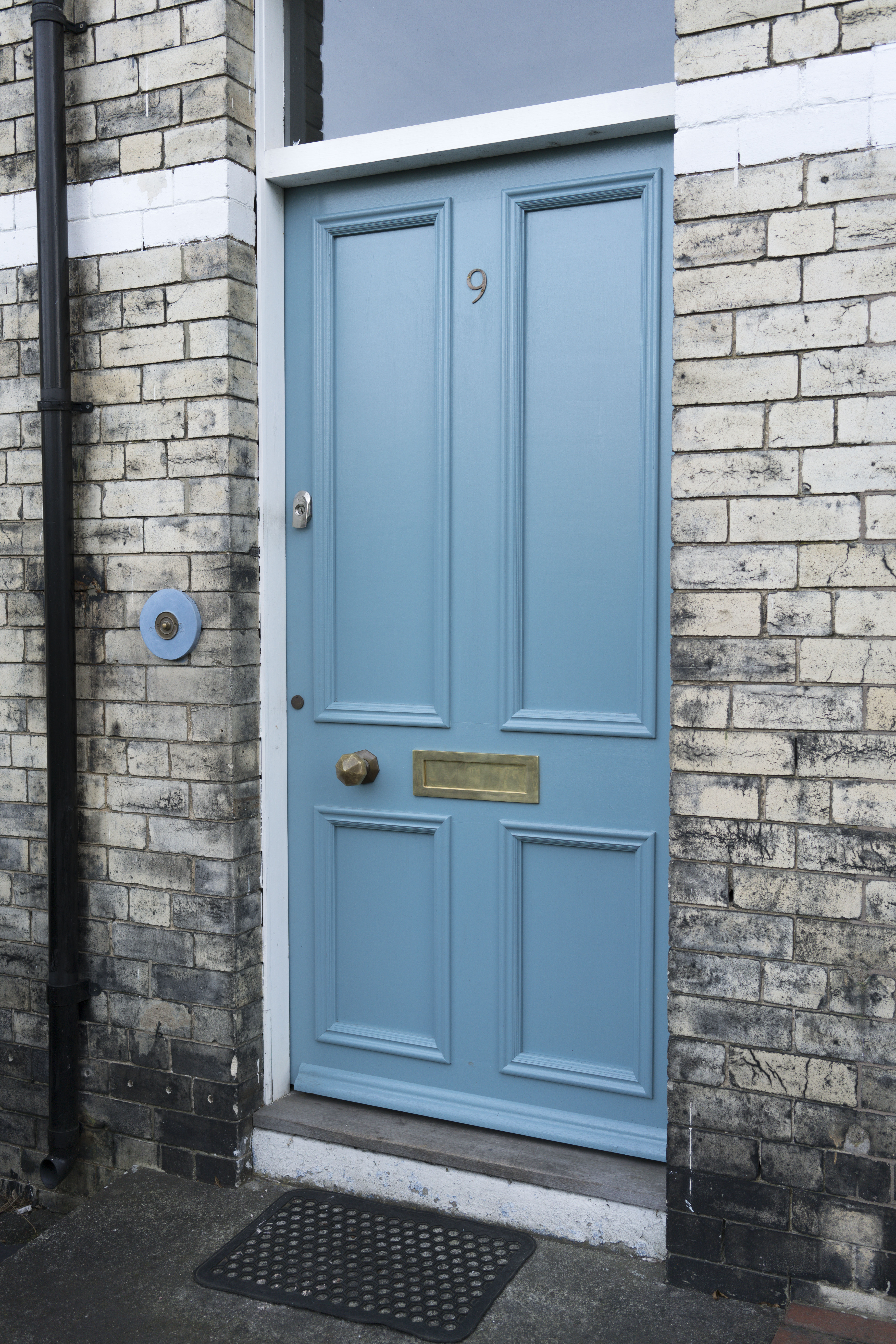 A Sapele door finished in stone blue